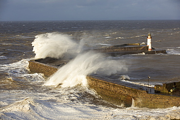 Storm waves from an extreme low pressure system batter Whitehaven harbour, Cumbria, UK, on the 10th December 2014.