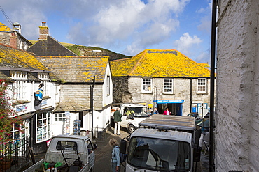 A traffic jam on the narrow Fore Street in Port Isaac in Cornwall, UK, a village made famous by the TV series Doc Martin.