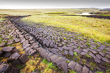 Peat cutting for fuel on the Isle of Lewis near Stornoway, Outer Hebrides, Scotland, UK.