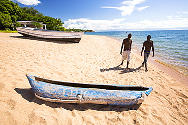 A traditional dug out canoe on a beach at Cape Maclear on the shores of Lake Malawi, Malawi, Africa.