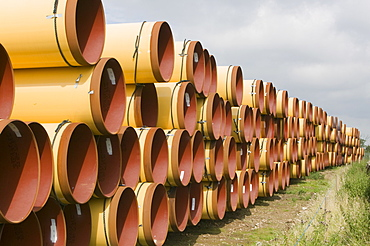 Pipes on a construction site to lay a pipeline from east to west coast of the UK for importing gas from the continent, Ingleton, Yorkshire, England, United Kingdom, Europe