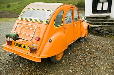 A Citroen 2CV painted bright orange, Lake District, Cumbria, England, United Kingdom, Europe