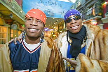 A fashion conscious couple of black men in the Trafford Centre in Manchester, England, United Kingdom, Europe