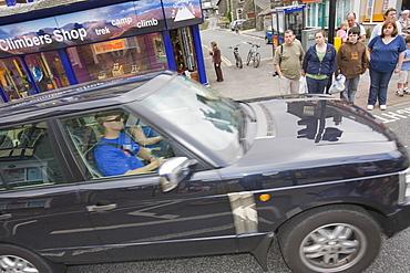 A gas guzzling Chelsea tractor driving through Ambleside, Cumbria, England, United Kingdom, Europe