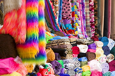 A market stall in Leicester selling colourful fabrics, Leicestershire, England, United Kingdom, Europe