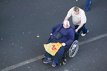 An obese disabled man in Leicester, Leicestershire, England, United Kingdom, Europe