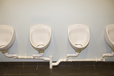 Water free urinals in a gents toilet for saving water