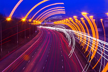 Car lights on the M1 motorway in Leicestershire, England, United Kingdom, Europe
