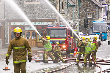 A fire being tackled by firemen in Ambleside, Lake Distruct, Cumbria, England, United Kingdom, Europe
