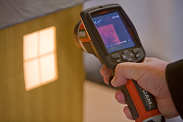 A thermal imaging camera being used to demonstrate heat loss on display at the Future Homes conference at the Crichton Carbon Centre in Dumfries, Scotland, United Kingdom, Europe