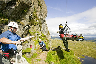 An injured climber with a dislocated shoulder is winched off Jacks Rake Pavey Ark by the Langdale Ambleside Mountain Rescue Team, Lake District, Cumbria, England, United Kingdom, Europe