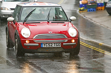 A car driving in the rain in Ambleside, Lake District, Cumbria, England, United Kingdom, Europe