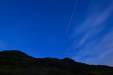 The constellation of the Plough and stars at night with a jet plane flying through, Lake District, Cumbria, England, United Kingdom, Europe