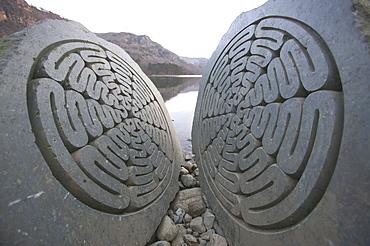 A split rock sculpture on Derwent Water, Keswick, Cumbria, England, United Kingdom, Europe