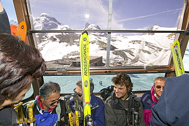 Summer skiers in the Klein Matterhorn cablecar above Zermatt, Switzerland, Europe