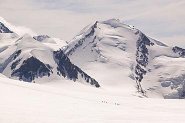 Climbers descending the Breithorn above Zermatt, Switzerland, Europe
