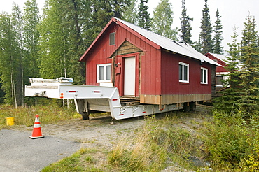 House in Fairbanks, moved after it started collapsing into the ground due to global warming induced permafrost melt, Alaska, United States of America, North America