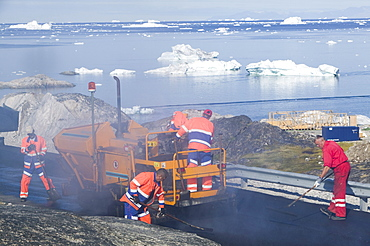 Laying tarmac on a road in Ilulissat on Greenland, Polar Regions
