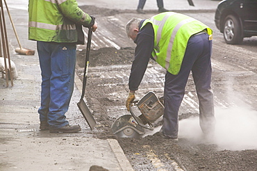 Roadworkers in Ambleside, Cumbria, England, United Kingdom, Europe