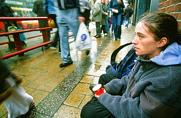 A homeless woman sleeping rough and begging on the streets of Leeds, Yorkshire, England, United Kingdom, Europe