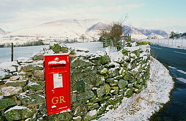 A rural postbox in St. Johns in the Vale in winter, near Keswick, Lake District, Cumbria, England, United Kingdom, Europe