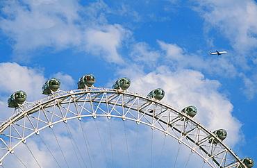 A plane flying over the London Eye, London, England, United Kingdom, Europe