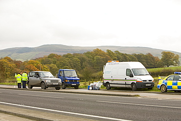 HM Revenue and Customs stopping vehicles and dipping petrol tanks to test for illegal use of red diesel to avoid paying duty, near Skipton, Yorkshire, England, United Kingdom, Europe