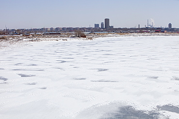 The Songhue river frozen solid in winter in Harbin, Heilongjian province, Northern China, Asia