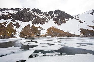 A frozen lochan in Corrie an Lochain in the Cairngorm mountains, Scotland, United Kingdom, Europe