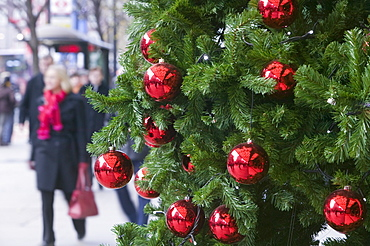 A Christmas tree outside a department store on Oxford Street in London, England, United Kingdom, Europe
