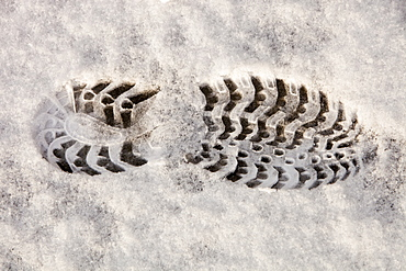 A bootprint in the snow in Ambleside, Cumbria, England, United Kingdom, Europe