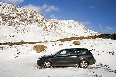 A car abandoned in the snw on Kirkstone Pass in the Lake District, Cumbria, England, United Kingdom, Europe