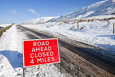A road closed sign on top of Kirkstone Pass in winter, Lake District, Cumbria, England, United Kingdom, Europe