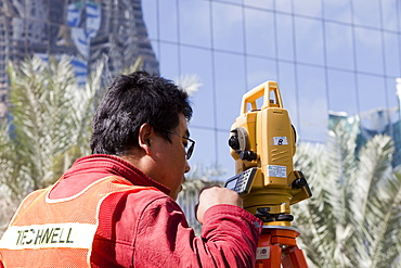 A surveyor working on a construction project in Dubai, United Arab Emirates, Middle East