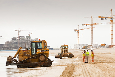 Workers creating a new beach resort on the Palm development in Dubai, United Arab Emirates, Middle East