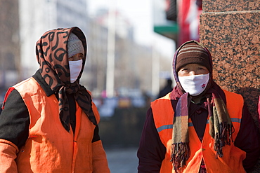 Road sweepers wear a face masks against the awful air pollution in Harbin city, Heilongjiang, Northern China, Asia