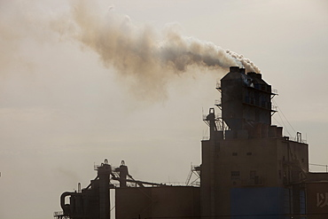 A coal fired cement factory billows smoke in Inner Mongolia, China, Asia