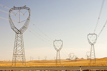 Electricity pylons march across Inner Mongolia in Northern China, Asia