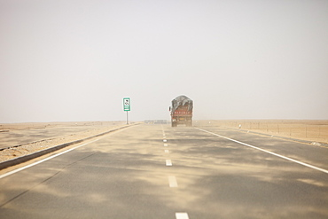 A sand storm sweeps across a highway in Inner Mongolia, China, Asia