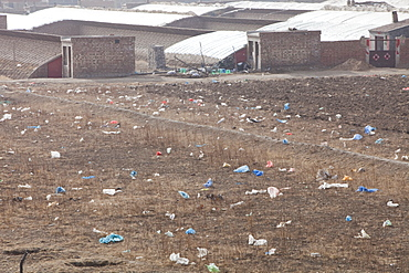 Plastic rubbish blows across the desert landscape of Inner Mongolia, China, Asia