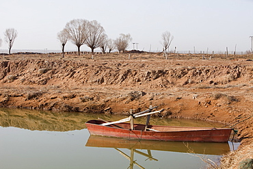 A small reservoir has been dug out in an attempt to find water, the original lake bed level was the highest ground level visible on the picture, Hong Hai Zai, near Dongsheng, Inner Mongolia, China, Asia