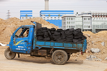 Lorry taking coal to a coal fired power plant in Dongsheng, Inner Mongolia, China, Asia
