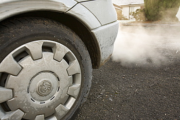 Exhaust fumes from a car exhaust pipe in freezing weather, United Kingdom, Europe
