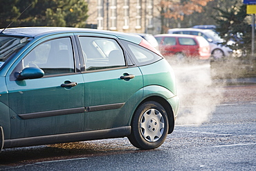 Exhaust fumes from a car exhaust pipe in freezing weather, Ambleside, Cumbria, England, United Kingdom, Europe