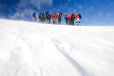 A group of mountaineers ascending Cairngorm in the Cairngorm National Park in Scotland, United Kingdom, Europe