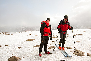 Ski mountaineers on the summit of Cairngorm in Scotland, United Kingdom, Europe