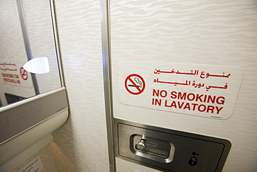 A no smoking sign in an airplane toilet