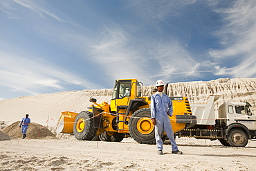 Arab workers working on a reclamation scheme to build another exclusive hotel resort on what was formerly seabed in Dubai, United Arab Emirates, Middle East