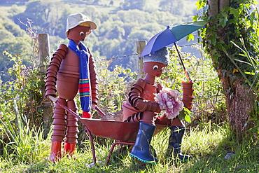Plantpot men in Berrynarbor village in north Devon, England, United Kingdom, Europe