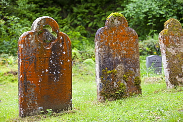 Gravestones in Culbone churchyard, said to be the smallest church in England, near Porlock Weir on the north Somerset coast,, England, United Kingdom, Europe